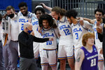 UCLA head coach Mick Cronin jokes with players in the final moments of their 67-47 win over Abilene Christian in a college basketball game in the second round of the NCAA tournament at Bankers Life Fieldhouse in Indianapolis Monday, March 22, 2021. (AP Photo/Mark Humphrey)