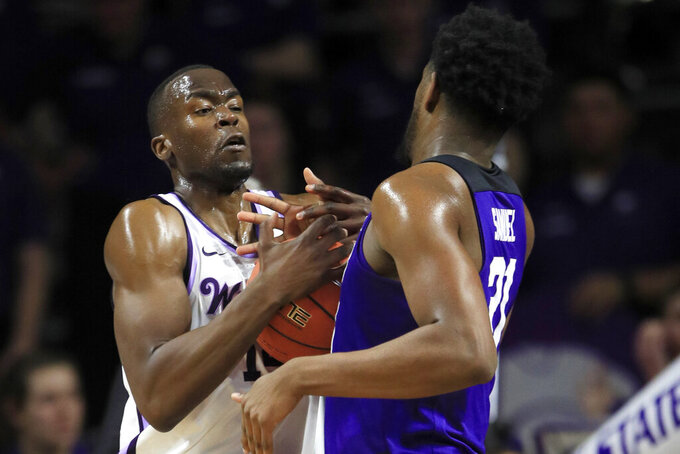 Kansas State forward Makol Mawien, left, rebounds against TCU center Kevin Samuel (21) during the first half of an NCAA college basketball game in Manhattan, Kan., Tuesday, Jan. 7, 2020. (AP Photo/Orlin Wagner)