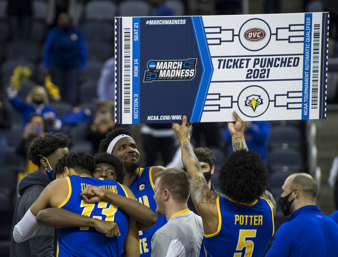 FILE - Morehead State players celebrate a victory over Belmont in an NCAA college basketball game for the Ohio Valley Conference men's tournament championship in Evansville, Ind., in this Saturday, March 6, 2021, file photo. (Sam Owens/Evansville Courier & Press via AP, File)