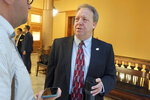 Kansas state Sen. Tom Holland, D-Baldwin City, talks to reporters after the Senate Commerce Committee's approval of a bill that would allow college athletes to hire agents and sign endorsement deals, Tuesday, March 10, 2020, at the Statehouse in Topeka, Kan. Holland's district includes part of Lawrence, Kan., home to the main University of Kansas campus. (AP Photo/John Hanna)