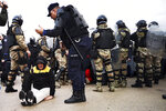 Police confront protesters at the garbage dump in Mostar, Bosnia-Herzegovina, Monday, Dec. 9, 2019. Authorities in the southern Bosnian city of Mostar dispatched police to remove residents who have been blocking access to the city's only landfill over concerns that it poses serious health and environmental risks. (AP Photo)