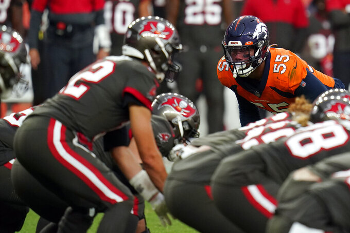 Denver Broncos outside linebacker Bradley Chubb, right, looks over the line as Tampa Bay Buccaneers quarterback Tom Brady, left, starts a play during the second half of an NFL football game Sunday, Sept. 27, 2020, in Denver. (AP Photo/Jack Dempsey)