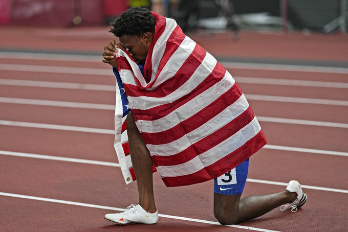 Noah Lyles, of the United States, reacts after his third place finish in the final of the men's 200-meters at the 2020 Summer Olympics, Wednesday, Aug. 4, 2021, in Tokyo. (AP Photo/David J. Phillip)