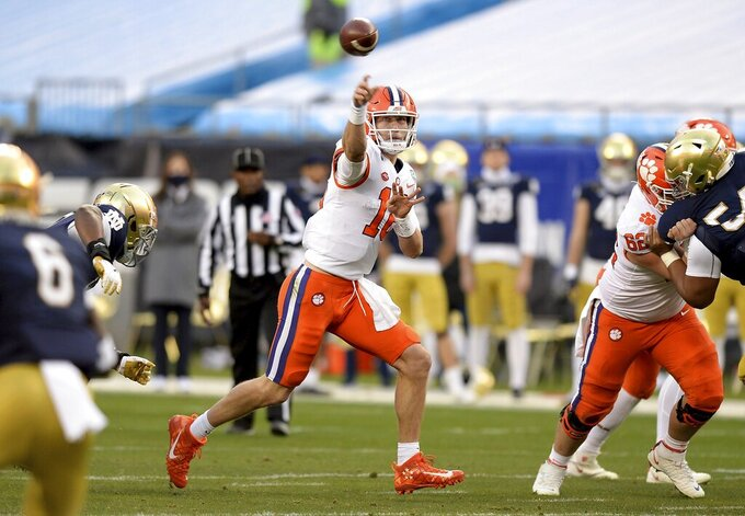 Clemson quarterback Trevor Lawrence against Notre Dame  during the Atlantic Coast Conference championship NCAA college football game, Saturday, Dec. 19, 2020, in Charlotte, N.C. (Jeff Siner/The News & Observer via AP)