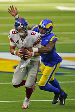 New York Giants quarterback Daniel Jones is sacked by Los Angeles Rams linebacker Justin Hollins during the second half of an NFL football game Sunday, Oct. 4, 2020, in Inglewood, Calif. (AP Photo/Ashley Landis)