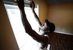 Contractor Daryl Neal hangs blinds inside a newly built house at 1995 Whitney in Frayser, Tenn. Wednesday, July 17, 2019. New affordable home construction in Frayser with assistance from the city through Housing and Community Development is part of an effort to overcome the lasting effects of the recession. (Mark Weber/Daily Memphian via AP)