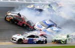 Clint Bowyer (14), Alex Bowman (88), Kyle Busch (18), Kyle Larson (42), Ryan Preece (47), Martin Truex Jr. (19), Chase Elliott (9), Austin Dillon (3) and Ryan Blaney (12) get caught up in a multi-car crash in Turn 1 during a NASCAR Cup Series auto race at Daytona International Speedway, Sunday, July 7, 2019, in Daytona Beach, Fla. (AP Photo/Dow Graham)