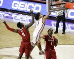 Oklahoma's Jalen Hill (1) dunks the ball against Alabama's Juwan Gary (4) and Herbert Jones (1) during the second half of an NCAA college basketball game in Norman, Okla., Saturday, Jan. 30, 2021. (AP Photo/Garett Fisbeck)