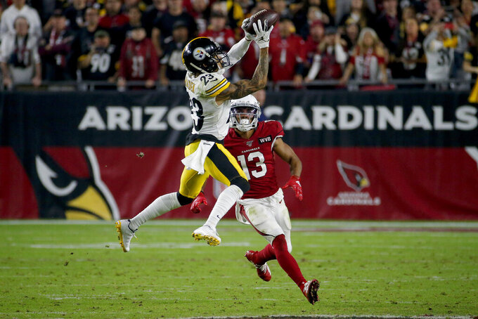 Pittsburgh Steelers cornerback Joe Haden (23) makes a game-ending interception intended for Arizona Cardinals wide receiver Christian Kirk (13) during the second half of an NFL football game, Sunday, Dec. 8, 2019, in Glendale, Ariz. The Steelers won 23-17. (AP Photo/Rick Scuteri)