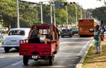 Women ride in the back of a vehicle in Havana, Cuba, Thursday, June 27, 2019. Cuban President Miguel Díaz-Canel says the country's governing council has approved economic measures including a rise in state salaries, long seen as a first step toward ending the country's dual-currency system which is expected to create a chain reaction that includes higher inflation. (AP Photo/Ismael Francisco)