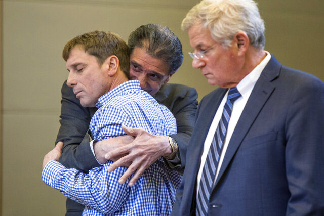 In this Thursday, Jan. 16, 2020 photo, David Carlson, left, reacts with his attorney Michael Mazzariello, center, after he was acquitted on charges of manslaughter and negligent homicide in Goshen, N.Y. Carlson faced the charges in relation to the 2013 fatal shooting of another man who was wanted on rape charges. (Allyse Pulliam/Times Herald-Record via AP)