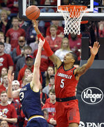 Louisville center Malik Williams (5) blocks the reverse layup attempt by Notre Dame forward John Mooney (33) during the second half of an NCAA college basketball game in Louisville, Ky., Sunday, March 3, 2019. Louisville won 75-61. (AP Photo/Timothy D. Easley)
