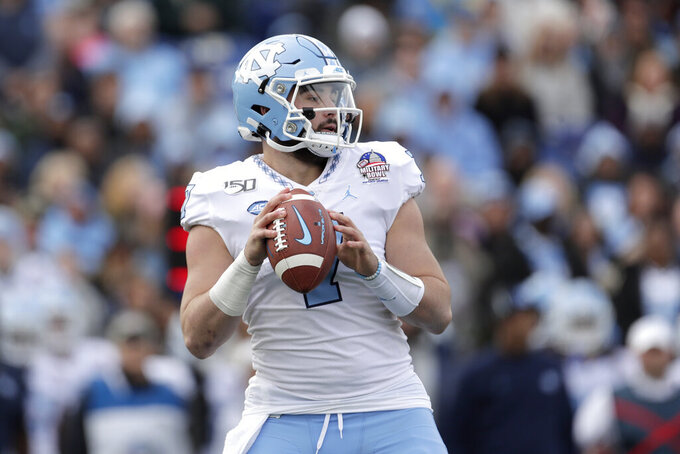 North Carolina quarterback Sam Howell looks to pass against Temple during the first half of the Military Bowl NCAA college football game, Friday, Dec. 27, 2019, in Annapolis, Md. (AP Photo/Julio Cortez)