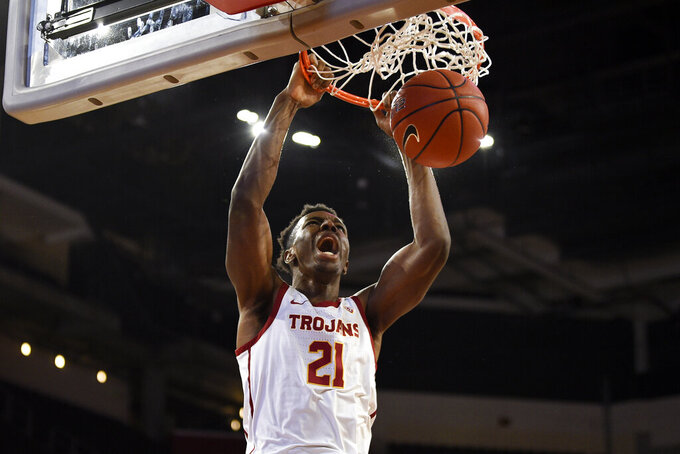 Southern California forward Onyeka Okongwu dunks during the first half of the team's NCAA college basketball game against Stanford in Los Angeles, Saturday, Jan. 18, 2020. (AP Photo/Kelvin Kuo)