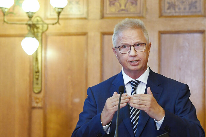 """In this Wednesday, Sept. 6, 2017, Hungarian Justice Minister Laszlo Trocsanyi attends a news conference after the decision of the Court of Justice of Luxembourg about the EU migrant quotas at the Parliament in Budapest, Hungary. Hungarian Prime Minister Viktor Orban said Friday on state radio that he expects former Hungarian justice minister Laszlo Trocsanyi, nominated as EU commissioner for neighborhood and expansion issues, to encounter """"heated moments"""" during upcoming hearings before the EU parliament's vote on the new EU Commission. (Szilard Koszticsak/MTI via AP)"""