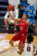 Texas Tech guard Kevin McCullar (15) shoots over Arkansas forward Justin Smith (0) in the first half of a second-round game in the NCAA men's college basketball tournament at Hinkle Fieldhouse in Indianapolis, Sunday, March 21, 2021. (AP Photo/Michael Conroy)