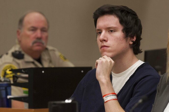 Defendant John Earnest listens during testimony by witness Oscar Stewart during Earnest's preliminary hearing, Thursday, Sept. 19, 2019, in Superior Court in San Diego. Prosecutors say Earnest opened fire during a Passover service at the Chabad of Poway synagogue on April 27, killing one woman and injuring three people, including the rabbi. (John Gibbins/The San Diego Union-Tribune via AP, Pool)