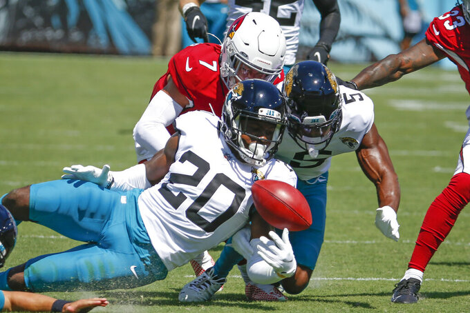Jacksonville Jaguars safety Daniel Thomas (20) and defensive back Rudy Ford (5) go after fumble against Arizona Cardinals cornerback Byron Murphy (7) on a kick off during the first half of an NFL football game, Sunday, Sept. 26, 2021, in Jacksonville, Fla. The Arizona Cardinals recovered the fumble. (AP Photo/Stephen B. Morton)