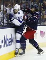 Columbus Blue Jackets' Josh Anderson, right, checks Tampa Bay Lightning's Braydon Coburn during the second period of Game 3 of an NHL hockey first-round playoff series Sunday, April 14, 2019, in Columbus, Ohio. (AP Photo/Jay LaPrete)
