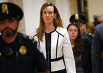 Jennifer Williams, a special adviser to Vice President Mike Pence for Europe and Russia who is a career foreign service officer, departs after a closed-door interview in the impeachment inquiry on President Donald Trump's efforts to press Ukraine to investigate his political rival, Joe Biden, at the Capitol in Washington, Thursday, Nov. 7, 2019. (AP Photo/J. Scott Applewhite)