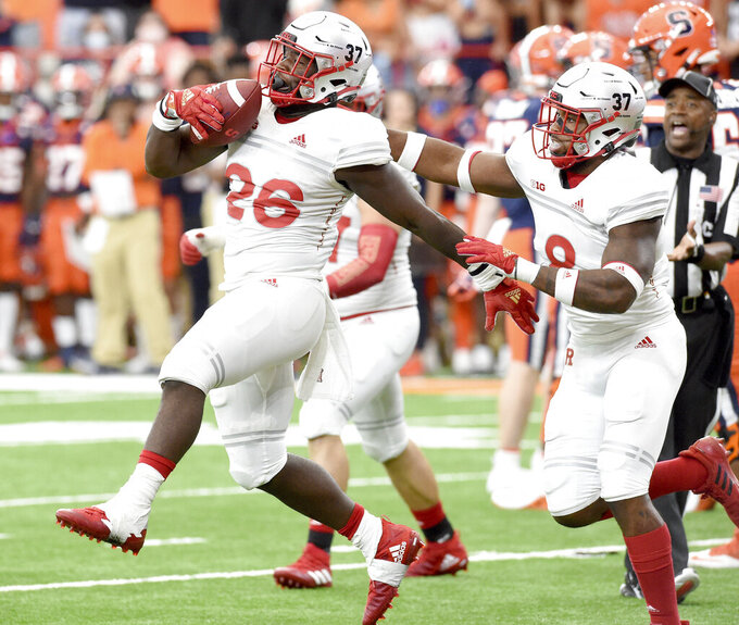 Rutgers defensive lineman CJ Onyechi (26) recovers a fumble in the fourth quarter of an NCAA college football game against Syracuse, Saturday, Sept. 11, 2021, at the Carrier Dome in Syracuse, N.Y. (Dennis Nett/The Post-Standard via AP)
