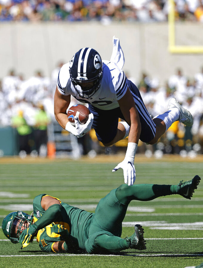 BYU tight end Isaac Rex (83) is hit by Baylor safety Jalen Pitre (8) during the first half of an NCAA college football game, Saturday, Oct. 16, 2021, in Waco, Texas. (AP Photo/Ron Jenkins)