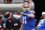 FILE -In this Nov. 2, 2019, file photo, Florida quarterback Kyle Trask throws a pass against Georgia during the first half of an NCAA college football game in Jacksonville, Fla. Isolated from coaches, teammates and friends during the coronavirus pandemic, Kyle Trask found plenty of extra free time this offseason. He reviewed each of his performances from his breakout year, trying to find and fix every flaw in hopes of improving the eighth-ranked Gators' chances of becoming Southeastern Conference and national championship contenders in 2020. (AP Photo/John Raoux, File)