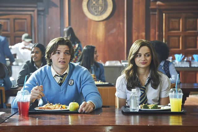 This image released by Netflix shows Joel Courtney, left, and Joey King in a scene from