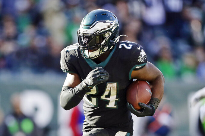FILE - In this Nov. 3, 2019, file photo, Philadelphia Eagles running back Jordan Howard carries the ball during an NFL football game against the Chicago Bears in Philadelphia. The Dolphins believe veteran newcomers Jordan Howard and Matt Breida represent a significant upgrade at the position, providing more punch and versatility for an offense that last year had the NFL's lowest rushing total since 2006. (AP Photo/Matt Rourke, File)