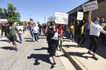 Gwen Swanigan, center, joins hundreds of people as they walk down Pipestone Street in Benton Harbor, Mich., Sunday, May 31, 2020, during a protest march concerning police brutality and the death of black men including George Floyd while being restrained by Minneapolis police. (Don Campbell/The Herald-Palladium via AP)