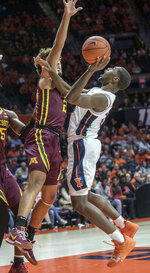 Illinois guard Da'Monte Williams (20) tries to muscle up a shot on Minnesota guard Gabe Kalscheur (22) during the first half of an NCAA college basketball game in Champaign, Ill., Wednesday, Jan. 16, 2019. (AP Photo/Rick Danzl)