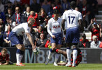Tottenham's Son Heung-Min, center, scuffles with Bournemouth's Jefferson Lerma, on the ground, during the English Premier League soccer match between AFC Bournemouth and Tottenham Hotspur at the Vitality Stadium in Bournemouth, England, Saturday May 4, 2019. Son was shown a red card by Referee Craig Pawson. (AP Photo/Matt Dunham)