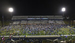 Georgia Southern fans and teammates fill the field after an NCAA college football game against Appalachian State, Thursday, Oct. 25, 2018, in Statesboro, Ga. (AP Photo/John Amis)
