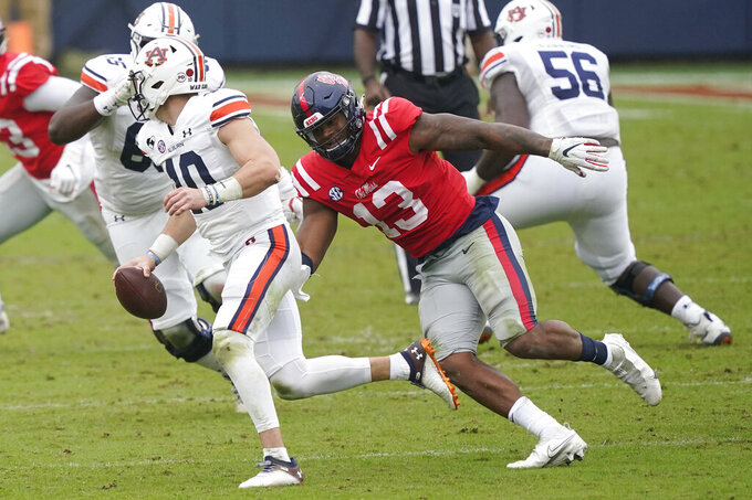 Auburn quarterback Bo Nix (10) is pursued by Mississippi linebacker Sam Williams (13) during the second half of an NCAA college football game in Oxford, Miss., Saturday Oct. 24, 2020. (AP Photo/Rogelio V. Solis)