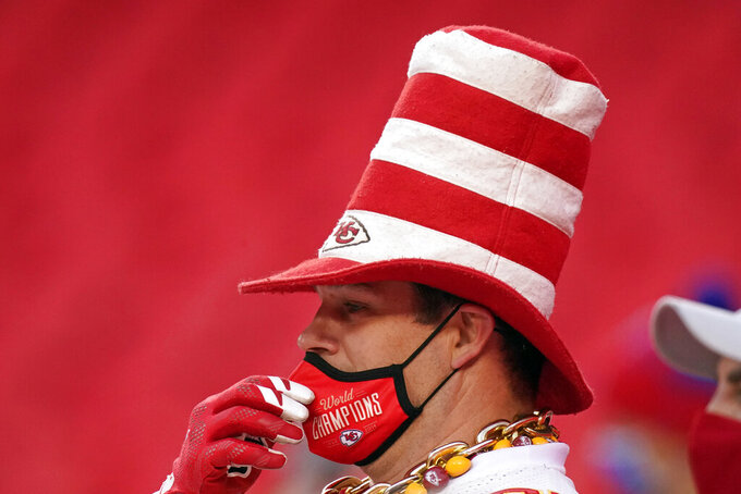 A fan watches players warm up before the AFC championship NFL football game between the Kansas City Chiefs and the Buffalo Bills, Sunday, Jan. 24, 2021, in Kansas City, Mo. (AP Photo/Charlie Riedel)