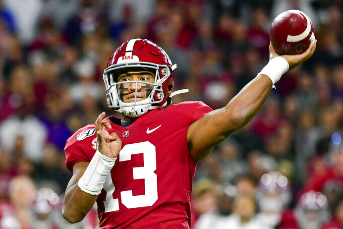 FILE - In this Nov. 9, 2019, file photo, Alabama quarterback Tua Tagovailoa passes during an NCAA college football game against LSU in Tuscaloosa, Ala. Tagovailoa is a rarity in the NFL: a left-handed quarterback, something the league hasn't had in several years. (AP Photo/Vasha Hunt, File)