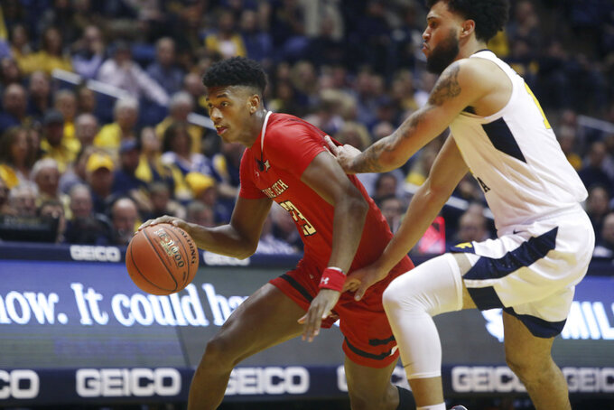 Texas Tech guard Jarrett Culver (23) drives while defended by West Virginia guard Jermaine Haley (10) during the first half of an NCAA college basketball game Wednesday, Jan. 2, 2019, in Morgantown, W.Va. (AP Photo/Raymond Thompson)