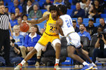 Arizona State forward Romello White (23) is defended by UCLA forward Jalen Hill (24) during the first half of an NCAA college basketball game Thursday, Feb. 27, 2020, in Los Angeles. (AP Photo/Ringo H.W. Chiu)