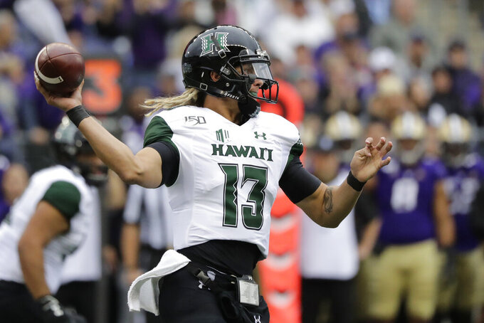 Hawaii quarterback Cole McDonald passes against Washington during the first half of an NCAA college football game, Saturday, Sept. 14, 2019, in Seattle. (AP Photo/Ted S. Warren)