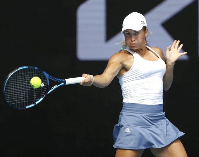 Kazakhstan's Yulia Putintseva hits a forehand to Ukraine's Elina Svitolina during their third round match at the Australian Open tennis championships in Melbourne, Australia, Saturday, Feb. 13, 2021. (AP Photo/Hamish Blair)