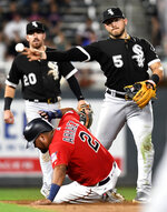 Chicago White Sox second baseman Yoimer Sanchez (5) gets the force-out against Minnesota Twins' Luis Arraez (2) and throws to complete a double play in the sixth inning of a baseball game Monday, Sept. 16, 2019, in Minneapolis. (AP Photo/Tom Olmscheid)