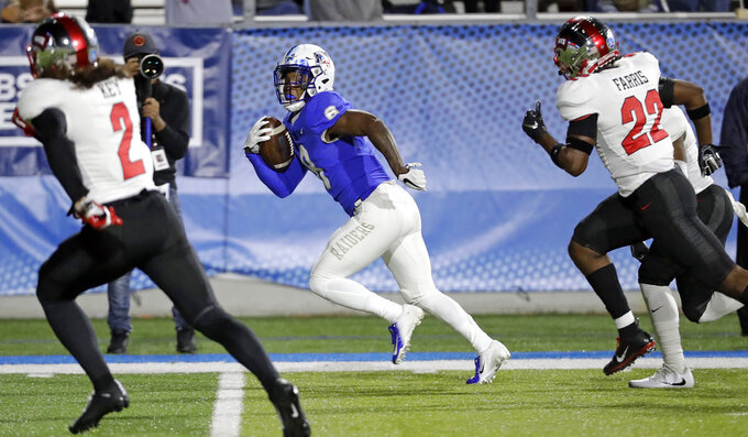 Middle Tennessee wide receiver Ty Lee (8) gets away from Western Kentucky defenders Devon Key (2) and DeAndre Farris (22) while scoring a touchdown on a 43-yard pass in the first half of an NCAA college football game Friday, Nov. 2, 2018, in Murfreesboro, Tenn. (AP Photo/Mark Humphrey)