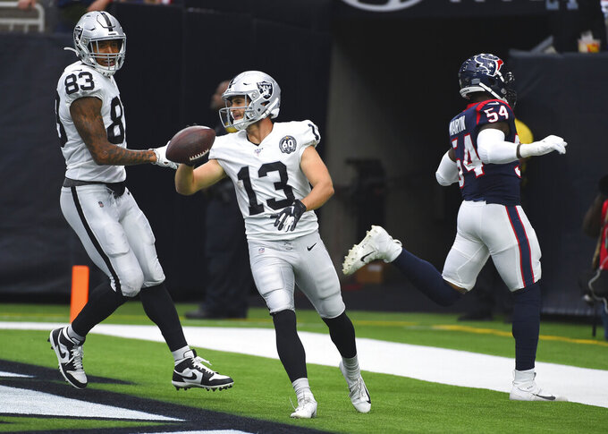 Oakland Raiders wide receiver Hunter Renfrow (13) celebrates his 65-yard touchdown catch against the Houston Texans during the first half of an NFL football game Sunday, Oct. 27, 2019, in Houston. (AP Photo/Eric Christian Smith)