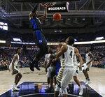 Duke's RJ Barrett (5) dunks against Wake Forest during the first half of an NCAA college basketball game in Winston-Salem, N.C., Tuesday, Jan. 8, 2019. (AP Photo/Chuck Burton)