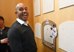 Baseball Hall of Fame inductee Mariano Rivera reacts after signing the backer board where his plaque will hang while visiting the National Baseball Hall of Fame and Museum, Friday, Feb. 1, 2019, in Cooperstown, N.Y. The former New York Yankees closer will be inducted on July 21. (AP Photo/Hans Pennink)