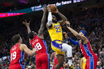 Los Angeles Lakers forward LeBron James, center right, goes up for the shot with Philadelphia 76ers forward Tobias Harris, right, and Shake Milton, center left, defending during the first half of an NBA basketball game, Saturday, Jan. 25, 2020, in Philadelphia. (AP Photo/Chris Szagola)