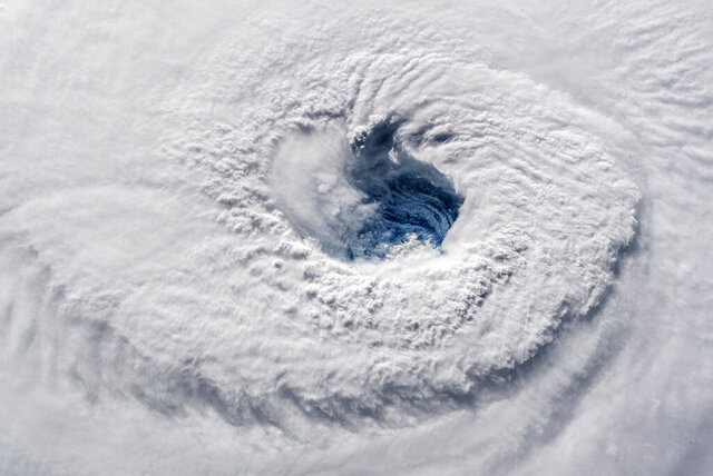FILE - In this Sept. 12, 2018 photo provided by NASA, Hurricane Florence churns over the Atlantic Ocean heading for the U.S. east coast as seen from the International Space Station. Astronaut Alexander Gerst, who shot the photo, tweeted: