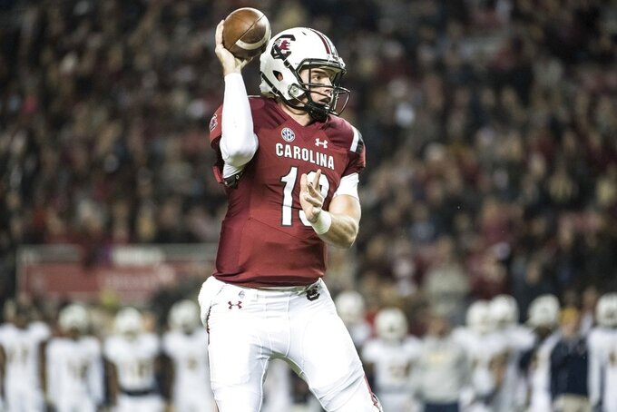 South Carolina quarterback Jake Bentley (19) throws a pass during the first half of an NCAA college football game against Chattanooga, Saturday, Nov. 17, 2018, in Columbia, S.C. South Carolina defeated Chattanooga 49-9. (AP Photo/Sean Rayford)