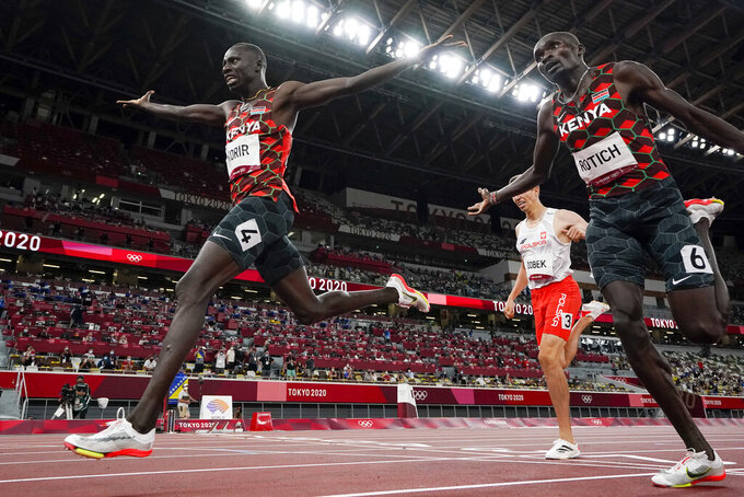 Emmanuel Korir, left, of Kenya, celebrates after winning the gold medal with silver medalist Ferguson Rotich, also of Kenya, in the men's 800-meter final at the 2020 Summer Olympics, Wednesday, Aug. 4, 2021, in Tokyo. (AP Photo/David J. Phillip)