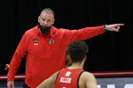 Utah head coach Larry Krystkowiak, left, speaks with forward Timmy Allen during the second half of the team's NCAA college basketball game against Washington State in Pullman, Wash., Thursday, Jan. 21, 2021. (AP Photo/Young Kwak)
